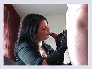 Sexy mature aunt smoking in leather gloves and boots
