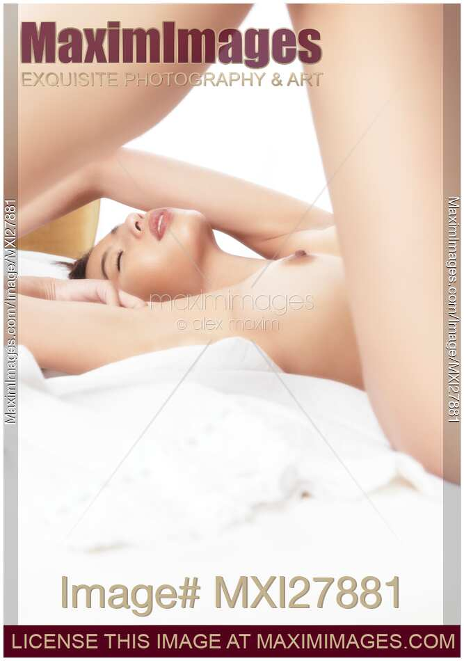 Naked woman lying on bed